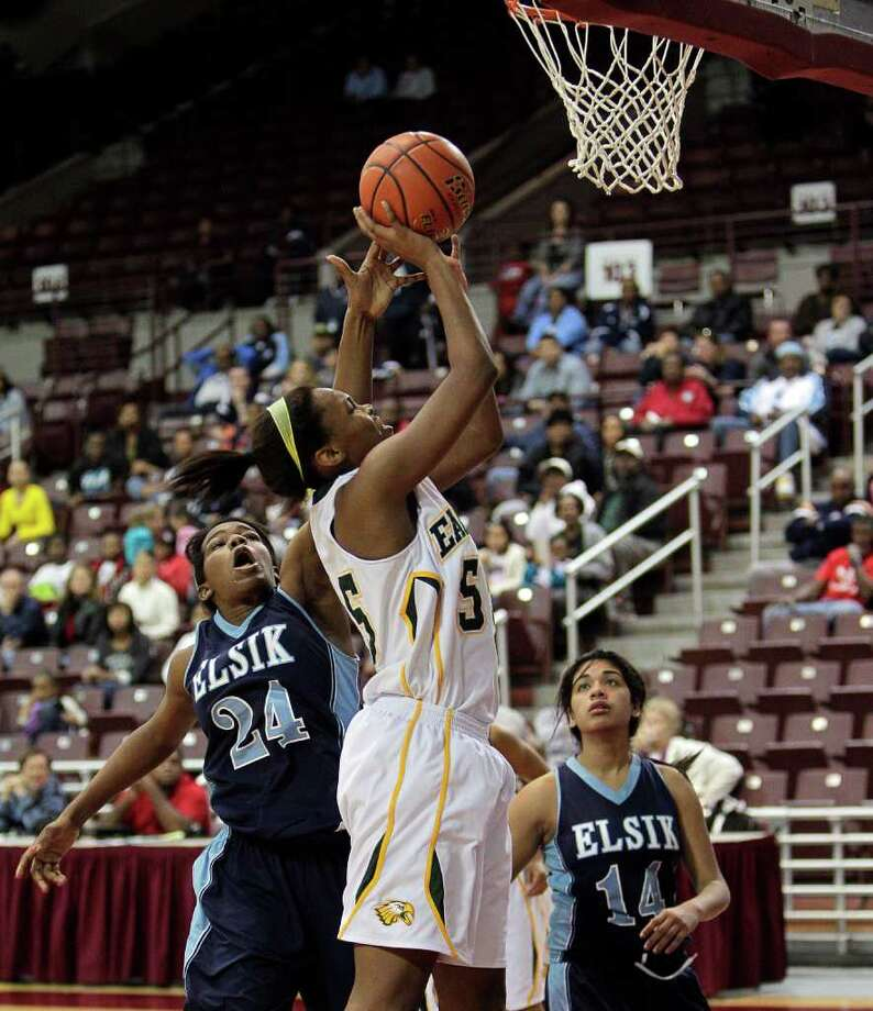Cy Falls' Carol Willie #55 drives t the basket during the Region III 5A girls basketball finals between Cy Falls and Alief Elsik at the M.O. Campbell Center Feb.  25, 2012 in Houston, Tx. Photo: Bob Levey, Houston Chronicle / ©2012 Bob Levey