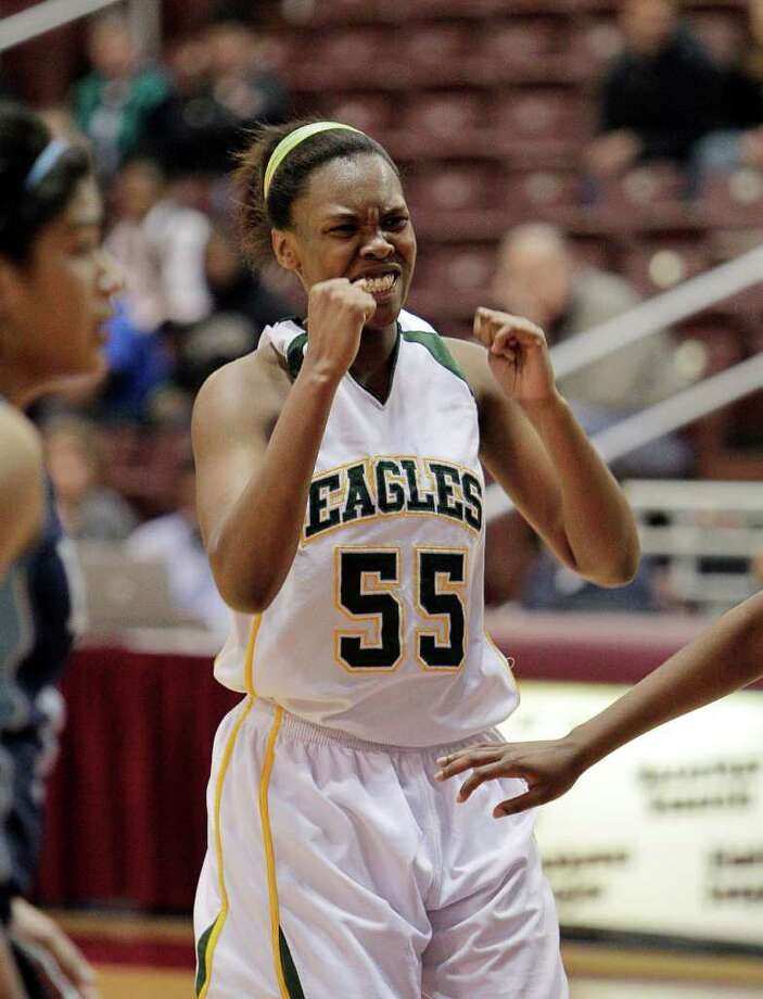 Cy Falls' Carol Willie #55 pumps her fists after making two big free throws down the end of the game during the Region III 5A girls basketball finals between Cy Falls and Alief Elsik at the M.O. Campbell Center Feb.  25, 2012 in Houston, Tx. Photo: Bob Levey, Houston Chronicle / ©2012 Bob Levey