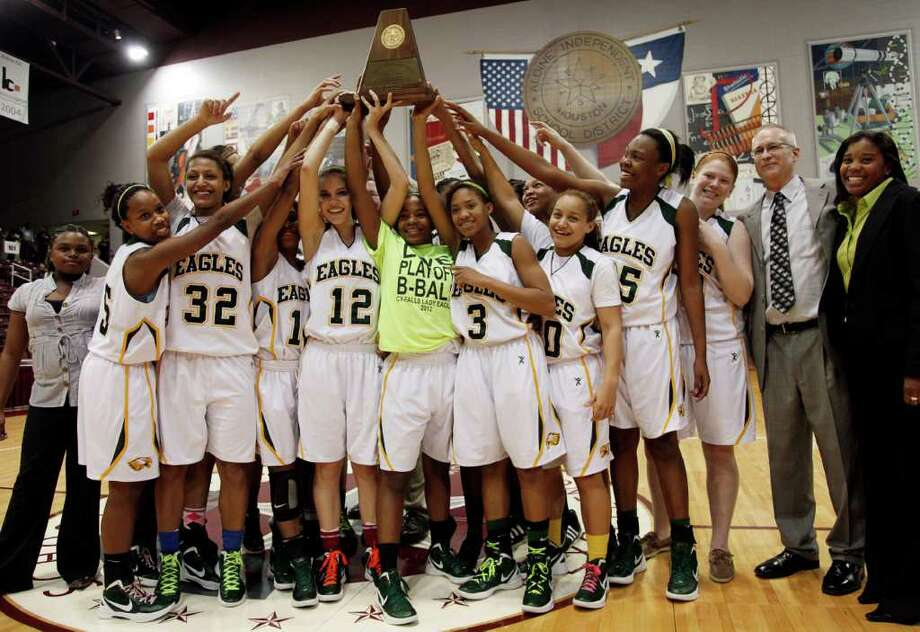 Cy Falls hoists their championship trophy during the Region III 5A girls basketball finals between Cy Falls and Alief Elsik at the M.O. Campbell Center Feb.  25, 2012 in Houston, Tx. Photo: Bob Levey, Houston Chronicle / ©2012 Bob Levey