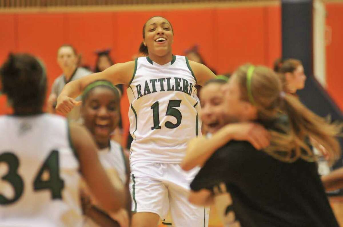 Reagan's Sabrina Berry smiles after the Rattlers defeated Wagner during the Region IV-5A championship on Saturday, Feb. 25, 2012, at UTSA's Convocation Center.