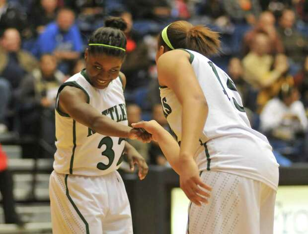Reagan's Moriah Mack (left) and Sabrina Berry congratulate each other near the end of their game against Wagner at the Region IV-5A championship on Saturday, Feb. 25, 2012, at UTSA's Convocation Center. Photo: Robin Jerstad, For The Express-News