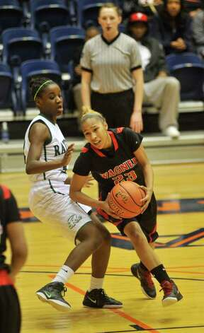 Wagner's Adriane Davis (23) drives on Reagan's Moriah Mack during the Region IV-5A championship on Saturday, Feb. 25, 2012, at UTSA's Convocation Center. Photo: Robin Jerstad, For The Express-News