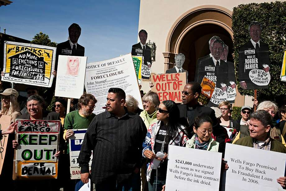 The Occupy Bernal Heights movement held a theatrical foreclosure outside Wells Fargo CEO John Stumpf's home on Larkin and Chestnut streets in San Francisco Saturday, February 26, 2012.    Jason Henry/Special to The Chronicle Photo: Jason Henry, Special To The Chronicle