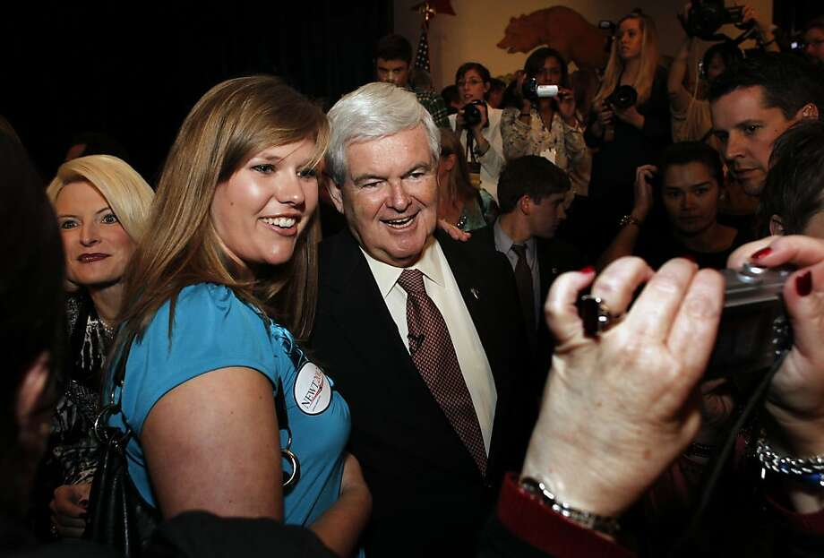 Presidential candidate and former house speaker, Newt Gingrich the keynote speaker at the afternoon luncheon, stops for a photograph with Hannah Plummer of Marina, Ca.,  following his speech on day two of the California Republic Party State Convention on Saturday Feb. 25, 2012, in Burlingame, Ca. Photo: Michael Macor, SFC