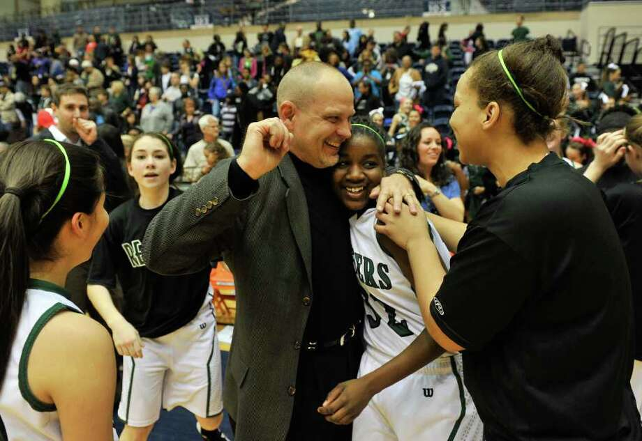 SLUG: BKG IV-5A finals-Photo request 56539-Feb. 25, 2011-San Antonio- Reagan coach Terry Barton celebrates with Moriah Mack and the rest of the team following their win in the Region IV-5A finals Saturday. Photo: Robin Jerstad, Robin Jerstad/For The Express-News