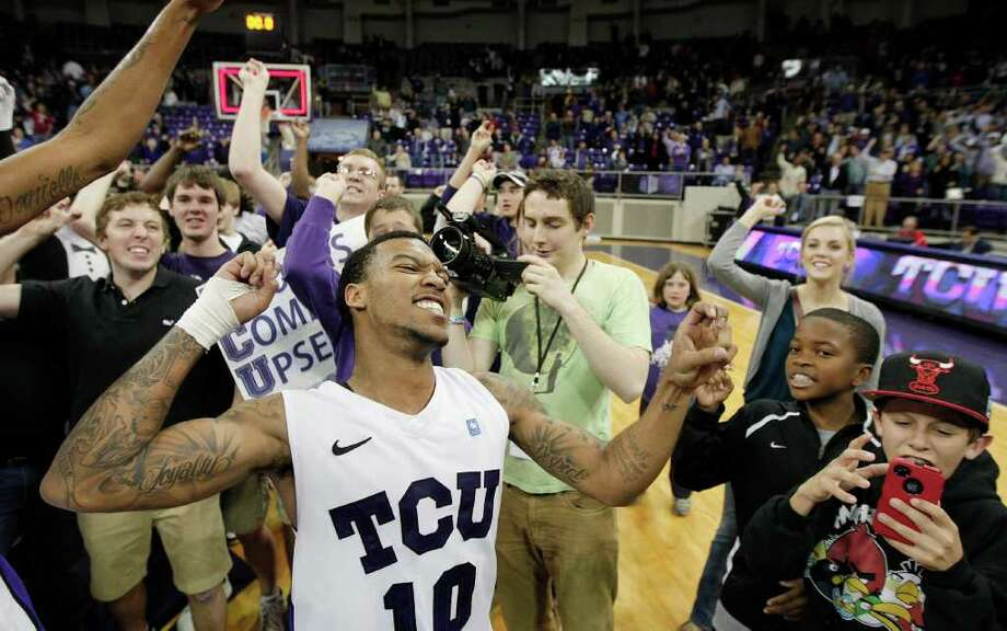 TCU guard Hank Thorns (10) celebrates with fans after defeating No. 18 New Mexico 83-64 in an NCAA college basketball game, Saturday, Feb. 25, 2012, in Fort Worth, Texas. Photo: AP