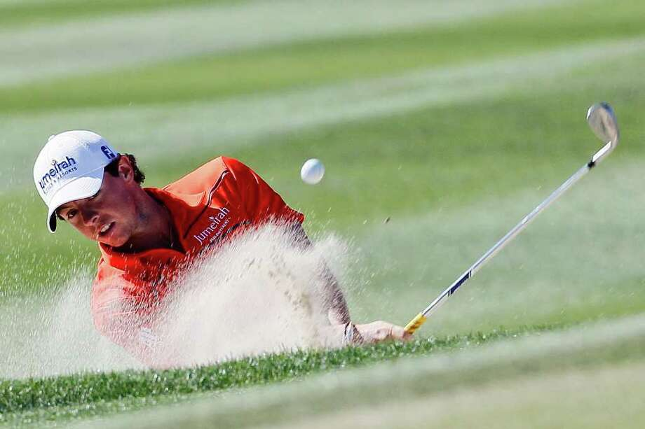 Northern Ireland's Rory McIlroy hits out of a bunker on the 13th fairway while playing South Korea's Bae Sang-moon during the Match Play Championship golf tournament, Saturday, Feb. 25, 2012, in Marana, Ariz. Photo: AP