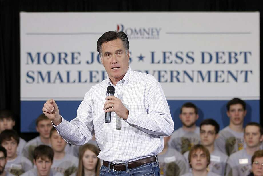 Former Massachusetts Gov. Mitt Romney speaks at a rally in Flint, Mich. Romney, a Michigan native, had been expected to win the state easily before Rick Santorum's recent surge. Photo: Bill Pugliano, Getty Images