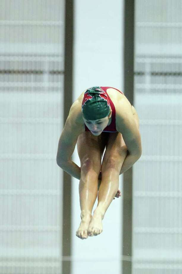 Kassidy Cook of The Woodlands dives during the Girls 1-Meter Diving finals during the UIL State Swimming and Diving Championships at the Lee and Joe Jamail Texas Swim Center,  Saturday, Feb. 25, 2012, in Austin.  Cook won the event with a score of 594.50. Photo: Smiley N. Pool, Houston Chronicle / © 2012  Houston Chronicle