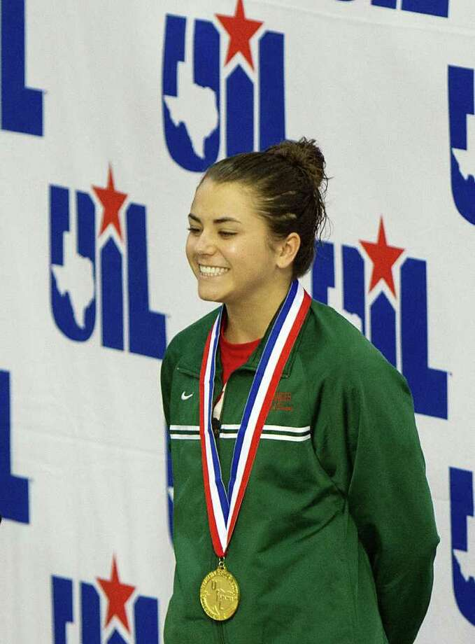 Kassidy Cook of The Woodlands smiles  on the awards podium after winning the Girls 1-Meter Diving finals during the UIL State Swimming and Diving Championships at the Lee and Joe Jamail Texas Swim Center,  Saturday, Feb. 25, 2012, in Austin.  Cook won the event with a score of 594.50. ( Smiley N. Pool / Houston Chronicle ) Photo: Smiley N. Pool / © 2012  Houston Chronicle