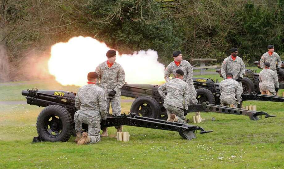 Members of the U.S. Army's 364th Sustainment Command fire cannons during the Ft. Lawton Post Closure Ceremony outside the Daybreak Star Indian Cultural Center in Seattle on Saturday, Feb. 25, 2012. Ft. Lawton was the second-largest deployment site on the West Coast during WWII, and was a major processing center during the Korean War. Photo: LINDSEY WASSON / SEATTLEPI.COM