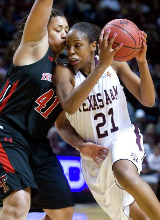 Texas A&M's Adaora Elonu (21), who scored 14 points, drives around Texas Tech's Kelsi Baker in the first half of Saturday's game at College Station. Photo: Stuart Villanueva / Bryan-College Station Eagle