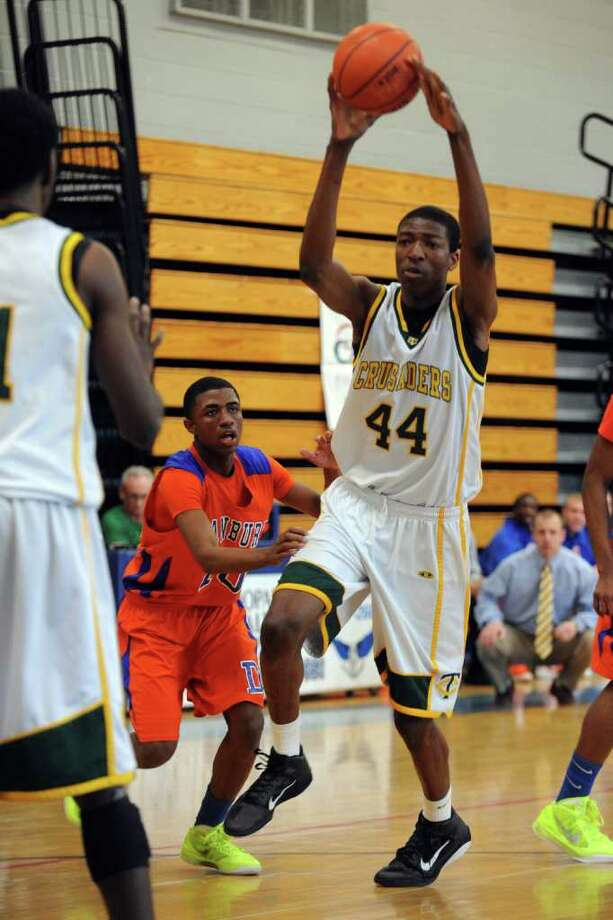 Trinity Catholic's Pascal Chukwu in action against Danbury during FCIAC boys basketball semifinal game at Fairfield Ludlowe High School, in Fairfield, Conn. Feb. 25th, 2012. Trinity Catholic defeated Danbury 62-56. Photo: Ned Gerard / Connecticut Post