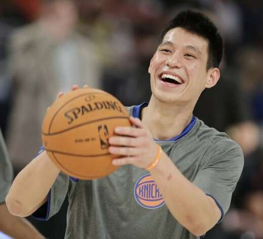 New York Knicks' Jeremy Lin laughs during warmups before the start of the NBA All-Star Rising Stars Challenge basketball game in Orlando, Fla. Friday, Feb. 24, 2012. (AP Photo/Chris O'Meara) (AP)