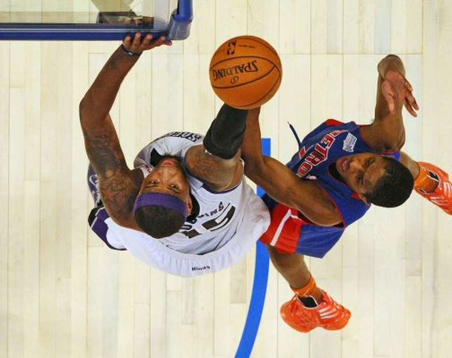 Team Chuck, Sacramento King's DeMarcus Cousins (15) aims for the basket as  Team Shaq, Detroit Pistons' Brandon Knight defends during the NBA All Star BBVA Rising Stars Challenge basketball game in Orlando, Fla. Friday, Feb. 24, 2012.(AP Photo/Gary Bogdon, Pool) (AP)