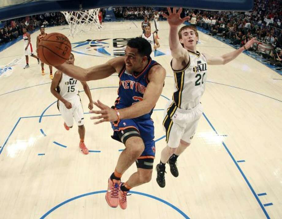 New York Knicks' Landry Fields (2), of Team Shaq, shoots past Utah Jazz's Gordon Hayward (20), of Team Chuck, during the NBA All-Star Rising Stars Challenge basketball game in Orlando, Fla. Friday, Feb. 24, 2012. (AP Photo/Mike Ehrmann, Pool) (AP)