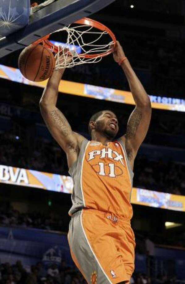 Phoenix Suns' Markieff Morris (11), of Team Shaq, dunks the ball during the NBA All-Star Rising Stars Challenge basketball game in Orlando, Fla. Friday, Feb. 24, 2012. (AP Photo/Chris O'Meara) (AP)