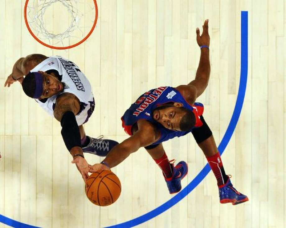 Detroit Pistons' Greg Monroe (15), right, of Team Shaq, and Sacramento Kings' DeMarcus Cousins, of Team Chuck, fight for a rebound during the NBA All-Star Rising Stars Challenge basketball game in Orlando, Fla. Friday, Feb. 24, 2012. (AP Photo/Gary Bogdon, Pool) (AP)