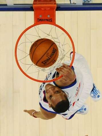 Philadelphia 76ers' Evan Turner, of Team Chuck, dunks the ball during the NBA All-Star Rising Stars Challenge basketball game in Orlando, Fla. Friday, Feb. 24, 2012. Team Chuck defeated Team Shaq 146-133. (AP Photo/Gary Bogdon, Pool) (AP)