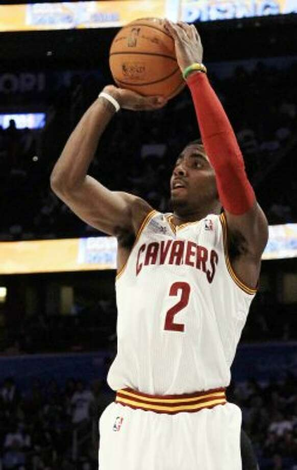 Cleveland Cavaliers' Kyrie Irving, of Team Chuck, shoots a 3-pointer during the NBA All-Star Rising Stars Challenge game in Orlando, Fla. Friday, Feb. 24, 2012. Team Chuck defeated Team Shaq 146-133. (AP Photo/Chris O'Meara) (AP)