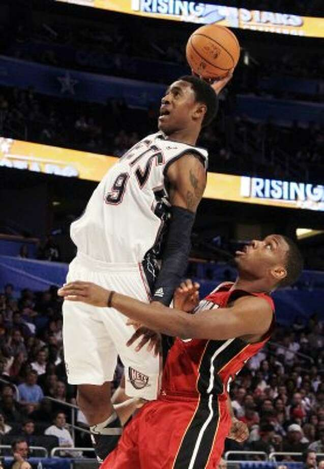 New Jersey Nets' MarShon Brooks (9), of Team Chuck, goes over Miami Heats' Norris Cole, of Team Shaq, during the NBA All-Star Rising Stars Challenge game in Orlando, Fla. Friday, Feb. 24, 2012. (AP Photo/Chris O'Meara) (AP)