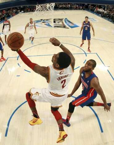 Cleveland Cavaliers' Kyrie Irving, of Team Chuck, drives to the basket during the NBA All-Star Rising Stars Challenge basketball game in Orlando, Fla., Friday, Feb. 24, 2012. Irving was the game's MVP as Team Chuck defeated Team Shaq 146-133. (AP Photo/Mike Ehrmann, Pool) (AP)
