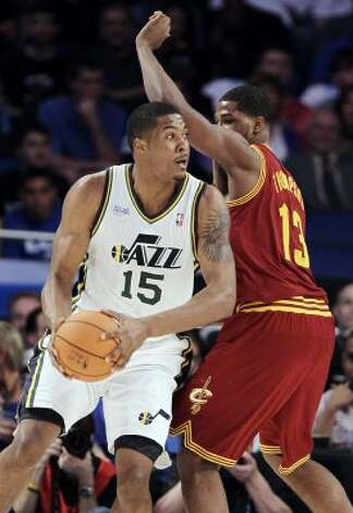 Utah Jazz's Derrick Favors (15), on Team Chuck, drives around Cleveland Cavaliers' Tristan Thompson (13), on Team Shaq, during the NBA All-Star Rising Stars Challenge basketball game in Orlando, Fla. Friday, Feb. 24, 2012. (AP Photo/Chris O'Meara) (AP)