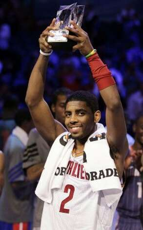 Cleveland Cavaliers' Kyrie Irving, of Team Chuck, hold the MVP trophy following the NBA All-Star Rising Stars Challenge game in Orlando, Fla. Friday, Feb. 24, 2012. Team Chuck defeated Team Shaq 146-133. (AP Photo/Chris O'Meara) (AP)