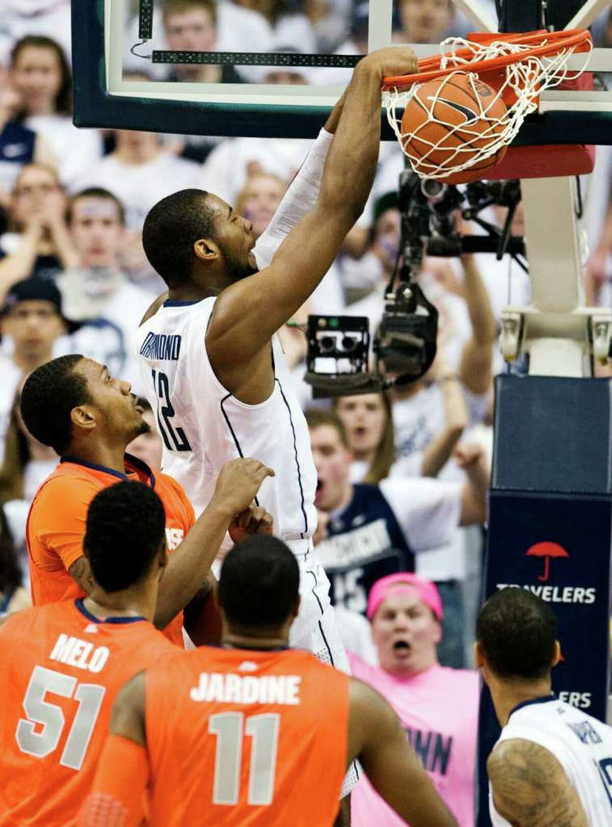 Connecticut's Andre Drummond dunks the ball in the first half of an NCAA college basketball game against Syracuse in Storrs, Conn., Saturday, Feb. 25, 2012. (AP Photo/Jessica Hill)
