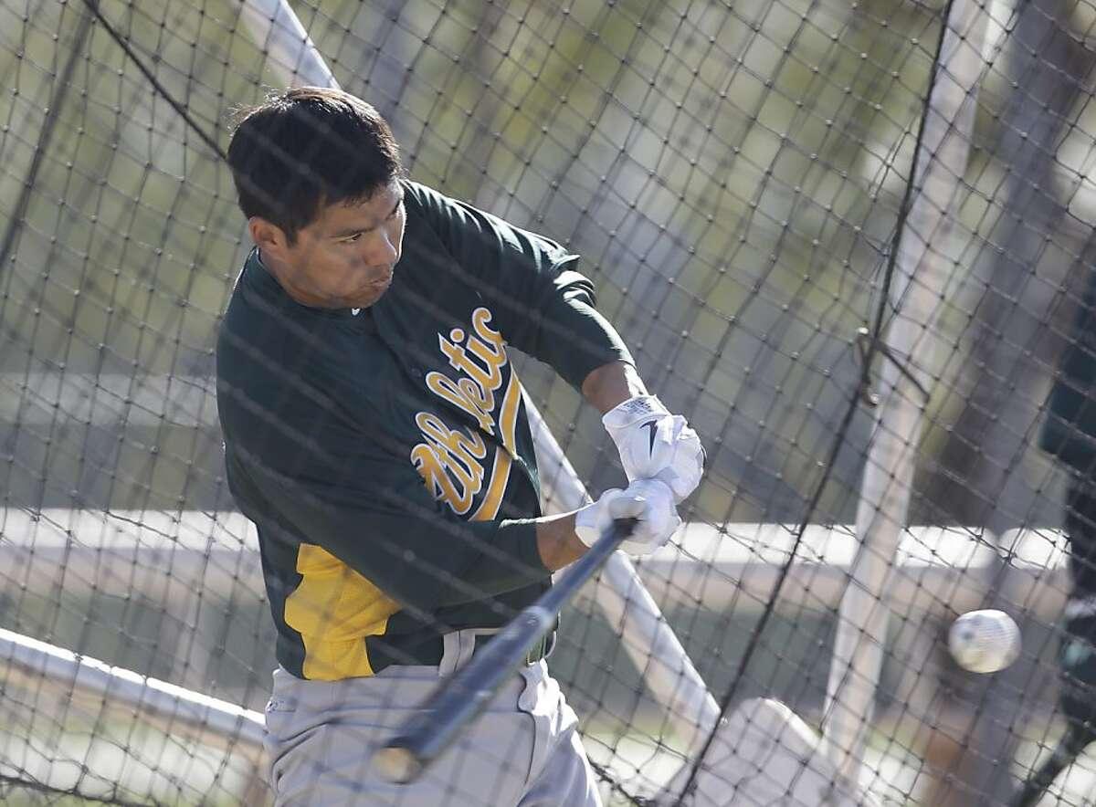 Oakland Athletics' Kurt Suzuki during a spring training baseball workout Tuesday, Feb. 21, 2012, in Phoenix. (AP Photo/Darron Cummings)
