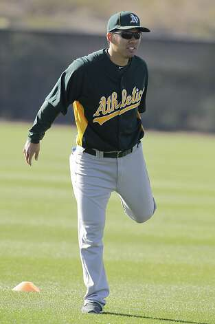Oakland Athletics' Kurt Suzuki during a spring training baseball workout Tuesday, Feb. 21, 2012, in Phoenix. (AP Photo/Darron Cummings) Photo: Darron Cummings, Associated Press