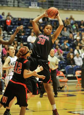 Wagner's Tesha Smith pulls down a rebound as Aundra Davis (12) moves in during the Region IV-5A championship against Reagan on Saturday, Feb. 25, 2012, at UTSA's Convocation Center. Photo: Robin Jerstad, For The Express-News