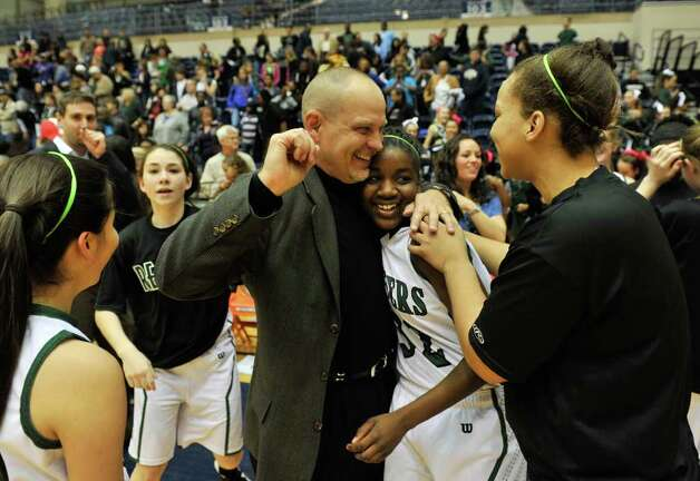 Reagan coach Terry Barton celebrates with player Moriah Mack and the rest of the team following their win in the Region IV-5A championship on Saturday, Feb. 25, 2012, at UTSA's Convocation Center. Photo: Robin Jerstad, For The Express-News