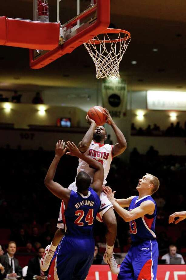 Houston guard Jonathon Simmons, 23, puts up a close jumper during the first half of an NCAA men's basketball game between the University of Houston Cougars and the Southern Methodist University Mustangs, Saturday, February 25, 2012, at Hofheinz Pavilion in Houston, Texas. Houston leads at the half 28-20. Photo: TODD SPOTH, For The Chronicle / © TODD SPOTH, 2012
