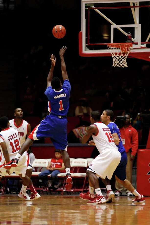 SMU guard Ryan Manuel, 1, puts up a jumper during the first half of an NCAA men's basketball game between the University of Houston Cougars and the Southern Methodist University Mustangs, Saturday, February 25, 2012, at Hofheinz Pavilion in Houston, Texas. Houston leads at the half 28-20. Photo: TODD SPOTH, For The Chronicle / © TODD SPOTH, 2012