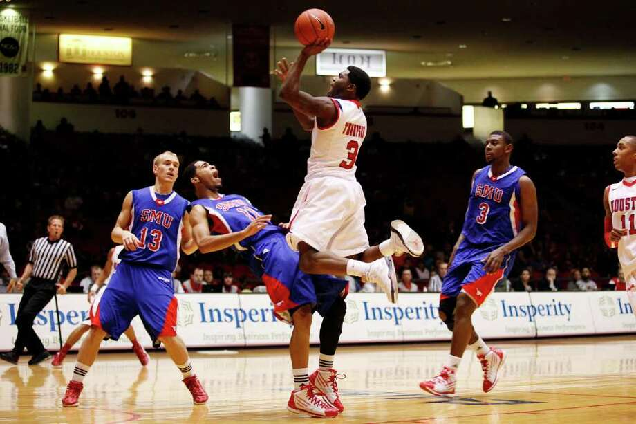 Houston guard J.J. Thompson, 3, charges the lane during the first half of an NCAA men's basketball game between the University of Houston Cougars and the Southern Methodist University Mustangs, Saturday, February 25, 2012, at Hofheinz Pavilion in Houston, Texas. Houston leads at the half 28-20. Photo: TODD SPOTH, For The Chronicle / © TODD SPOTH, 2012