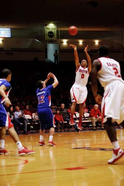 Houston guard Joseph Young, 0, shoots a three point shot during the second half of an NCAA men's bas