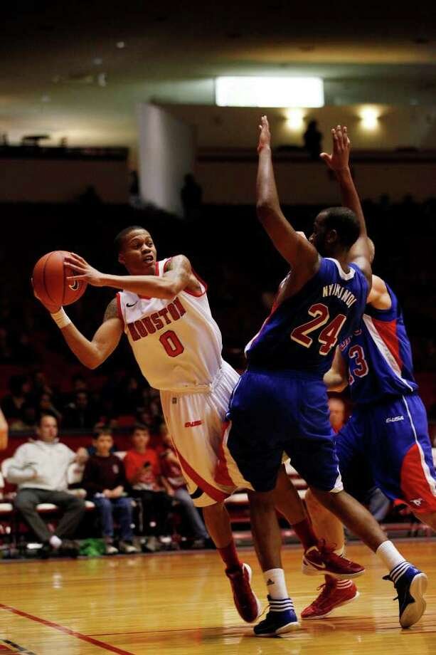 Houston guard Joseph Young, 0, makes a baseline pass during the second half of an NCAA men's basketball game between the University of Houston Cougars and the Southern Methodist University Mustangs, Saturday, February 25, 2012, at Hofheinz Pavilion in Houston, Texas. Houston won 62-59. Photo: TODD SPOTH, For The Chronicle / © TODD SPOTH, 2012