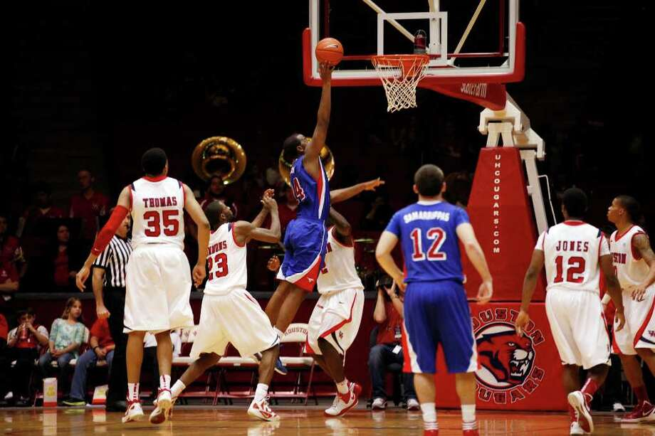 SMU forward Robert Nyakundi, 24, puts up a layup during the second half of an NCAA men's basketball game between the University of Houston Cougars and the Southern Methodist University Mustangs, Saturday, February 25, 2012, at Hofheinz Pavilion in Houston, Texas. Houston won 62-59. Photo: TODD SPOTH, For The Chronicle / © TODD SPOTH, 2012