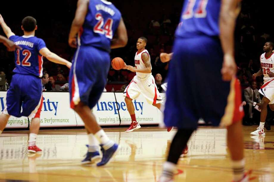 Houston guard Joseph Young, 0, drives the ball down the court during the first half of an NCAA men's basketball game between the University of Houston Cougars and the Southern Methodist University Mustangs, Saturday, February 25, 2012, at Hofheinz Pavilion in Houston, Texas.  Photo: TODD SPOTH, For The Chronicle / © TODD SPOTH, 2012