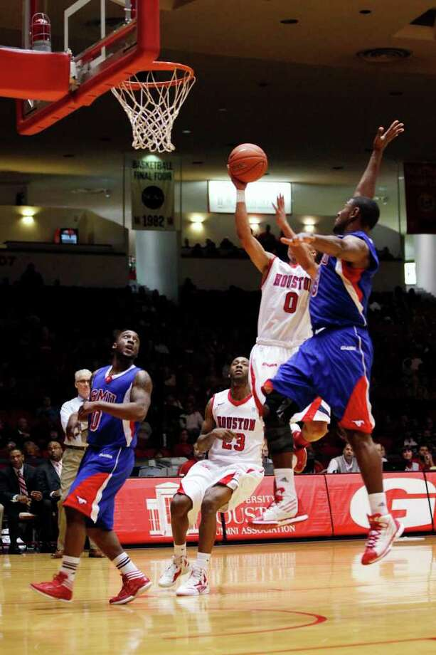 Houston guard Joseph Young, 0, drives to the basket during the first half of an NCAA men's basketball game between the University of Houston Cougars and the Southern Methodist University Mustangs, Saturday, February 25, 2012, at Hofheinz Pavilion in Houston, Texas.  Photo: TODD SPOTH, For The Chronicle / © TODD SPOTH, 2012