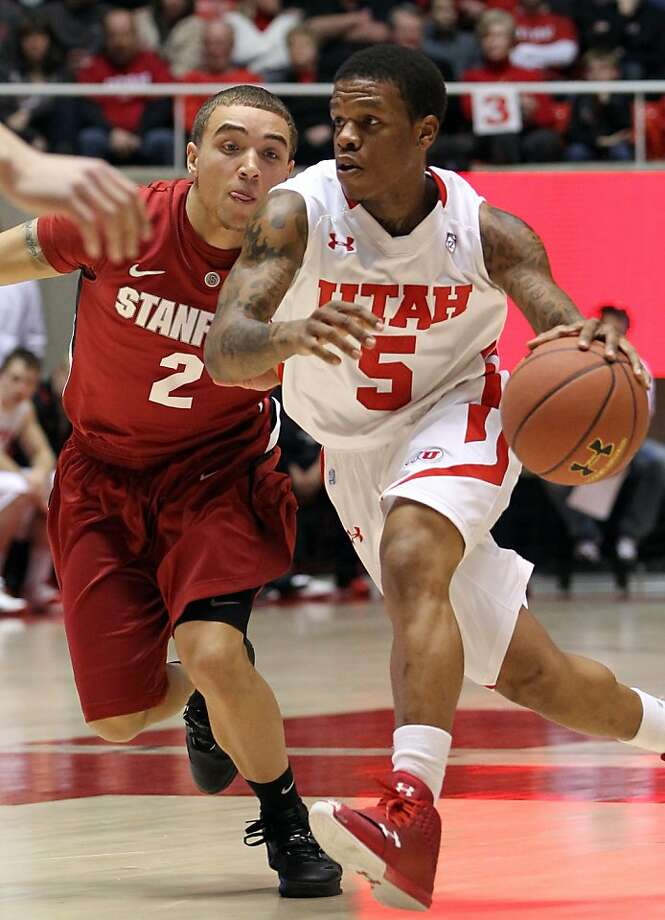 Utah guard Kareem Storey (5) drives against Stanford guard Aaron Bright (2) during the first half of an NCAA college basketball game, Saturday, Feb. 25, 2012, in Salt Lake City. (AP Photo/Colin E Braley) Photo: Colin E. Braley, Associated Press