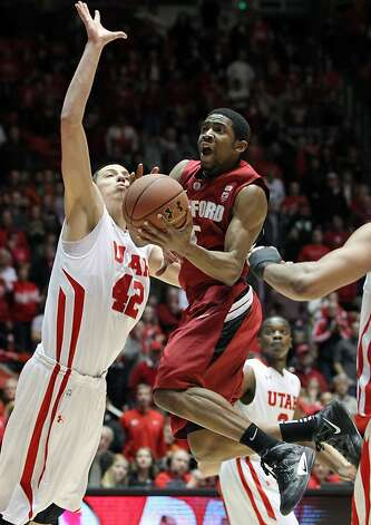 Stanford guard Chasson Randle, right, attempts to score past Utah center ...