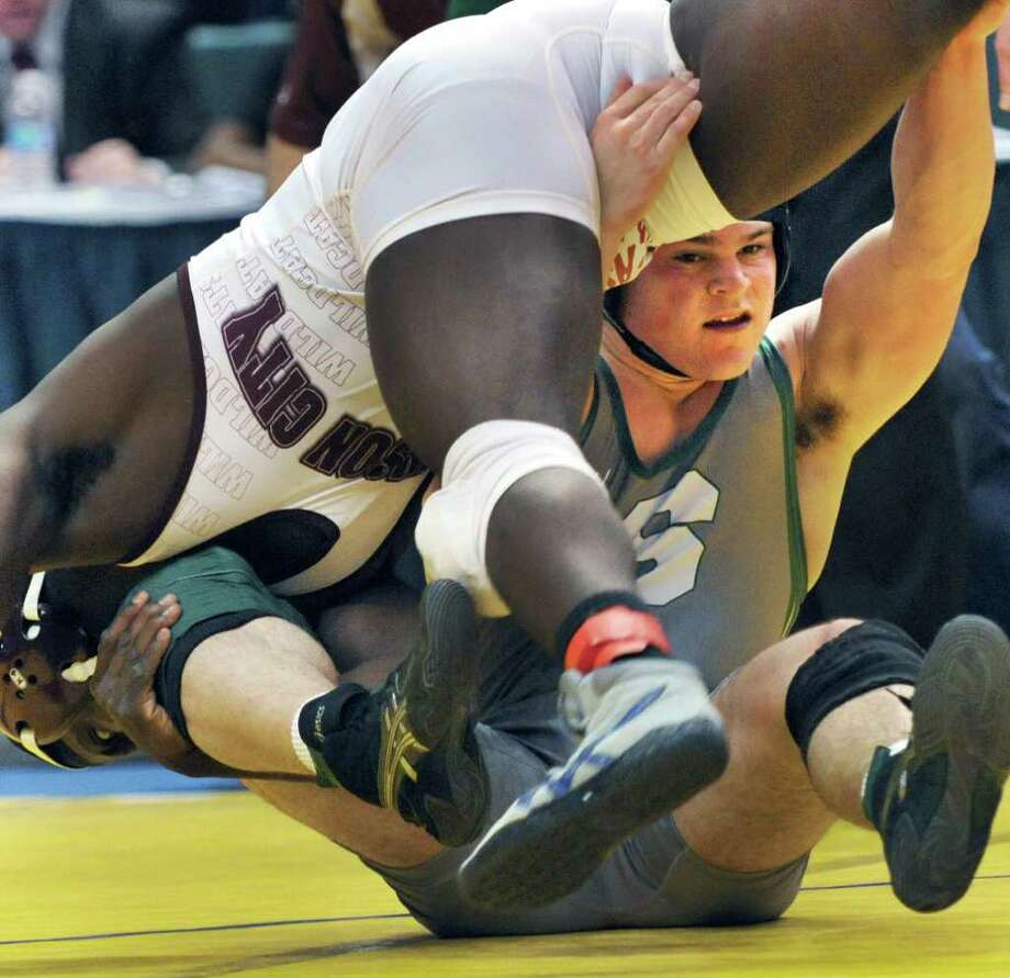 Shen's Tony Fusco, at right, defeats  Johnson City's Reggie Williams for the Division I 195 Lb. match final at the NYS wrestling tournament at the Times Union Center in Albany Feb. 25, 2012. (John Carl D'Annibale / Times Union) Photo: John Carl D'Annibale