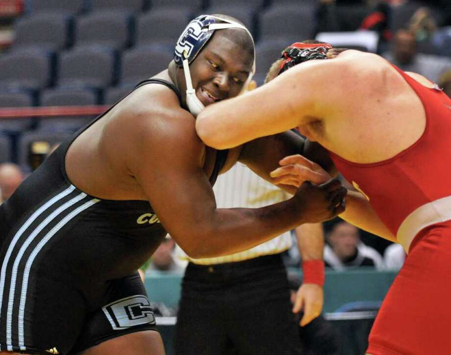 Columbia's El Shaddai Gilmore, left, battles Syosset's Evan Kappatos in the 285 lb. Division I match final at the NYS wrestling tournament at the Times Union Center in Albany Feb. 25, 2012. (John Carl D'Annibale / Times Union) Photo: John Carl D'Annibale
