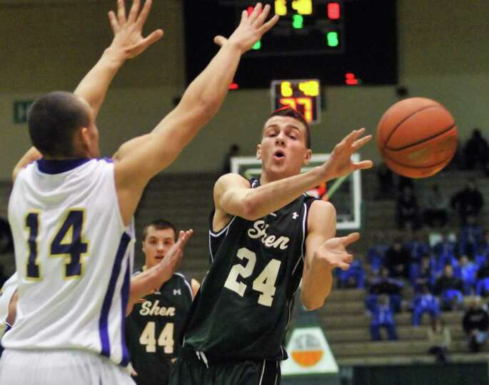 Shen's #24 Jake Hicks gets a pass by CBA's #14 Chaz Lott, left, in the Class AA boys' basketball qua