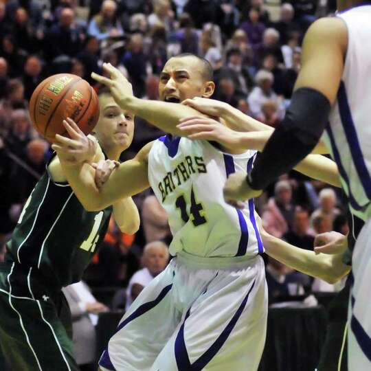 CBA's #14 Chaz Lott fights past Shen's #14 Teddy McCarthy, at left, during the Class AA boys' basket
