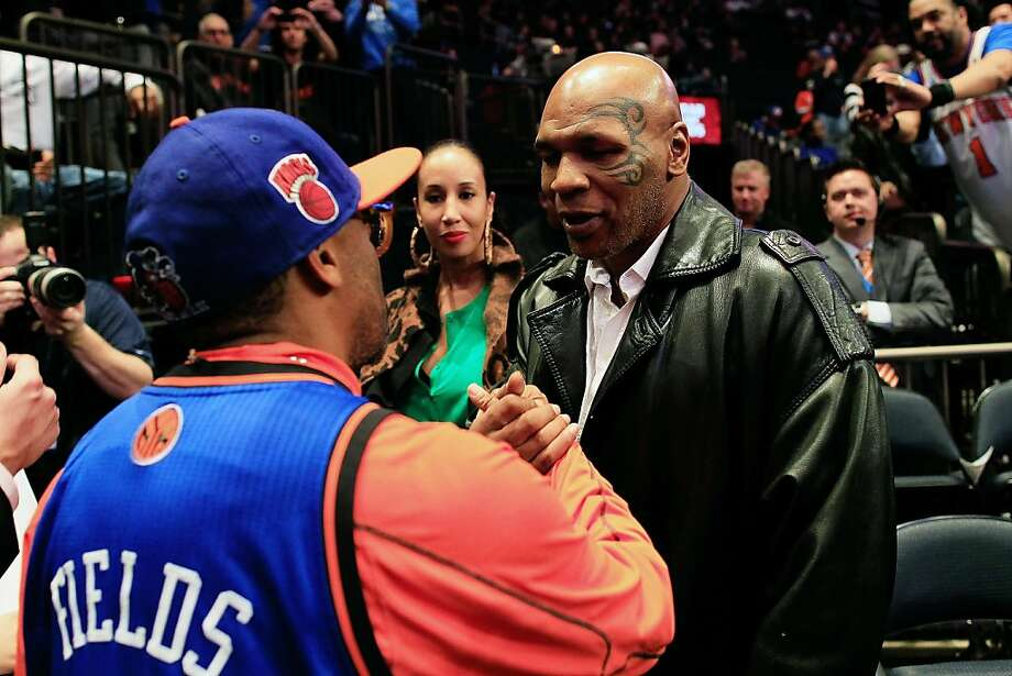 NEW YORK, NY - FEBRUARY 15: (L) Spike lee chats with (R) Mike Tyson before the game between the New York Knicks and the Sacramento Kings at Madison Square Garden on February 15, 2012 in New York City. NOTE TO USER: User expressly acknowledges and agrees that, by downloading and/or using this Photograph, user is consenting to the terms and conditions of the Getty Images License Agreement.  (Photo by Chris Trotman/Getty Images) Photo: Chris Trotman, Getty Images