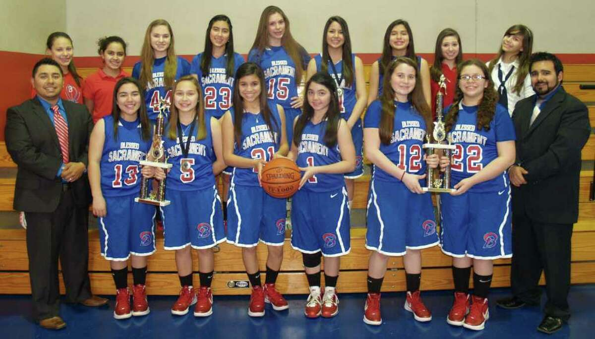 The Blessed Sacrament Lady Bulldogs, (front row, from left) head coach Andrew Torres, Brooke Orme, Avery Alva, Dominique Ramos, Daniella McCoy, Gianna Brown, Caitlyn Gonzales, assistant coach Johnnie Santos; (back row, from left) manager Andrea Hernandez, Isabella Lopez, Sabrina Gonzalez, Marissa Cuevas, Shelby Sheets, Ashley Suarez, Sophia Ramos, Manager Valencia Ramos, Desiree Esteves; Jocelyn Garcia (not pictured).