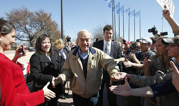 Republican presidential candidate Rep. Ron Paul, R-Texas, shakes hands as he arrives at a rally in Oklahoma City, Saturday, Feb. 25, 2012. (AP Photo/Sue Ogrocki) Photo: Sue Ogrocki, Associated Press